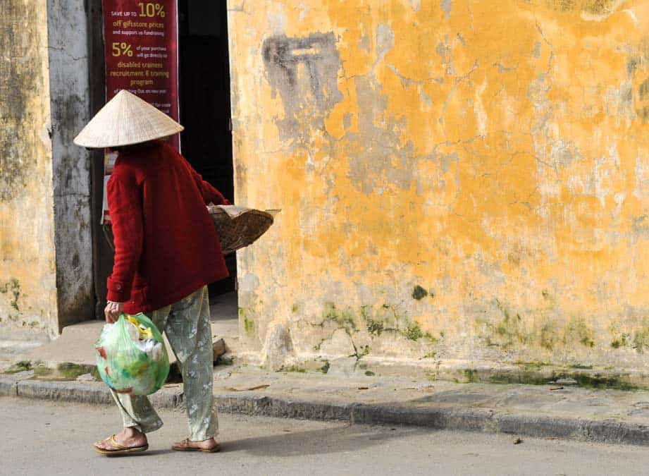 Vietnamese woman and yellow wall