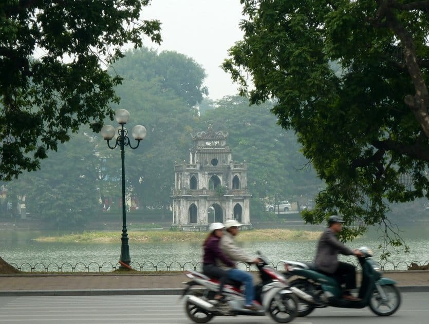 Scooters in Hanoi with Hoan Kiem Lake Pagoda in the background