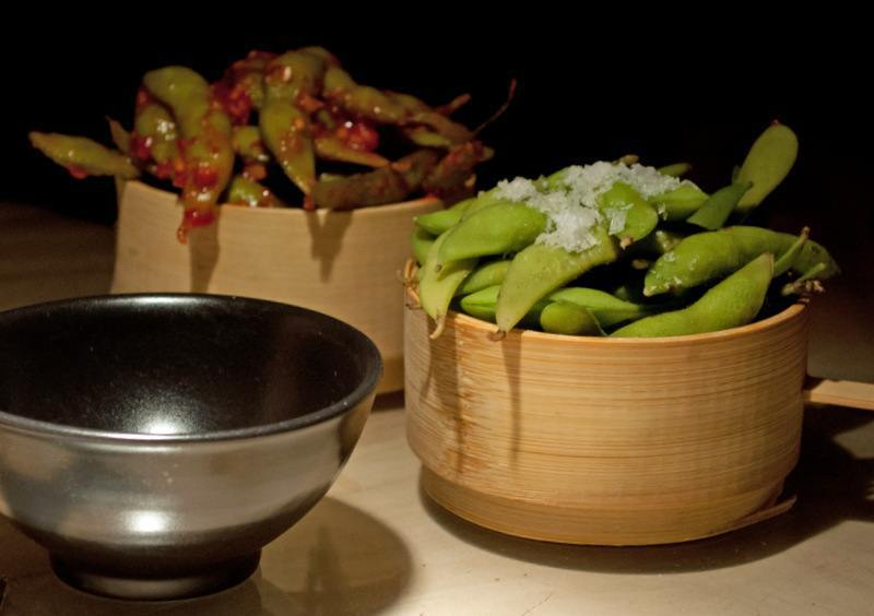 warm edamame beans in rock salt and chilli sauce