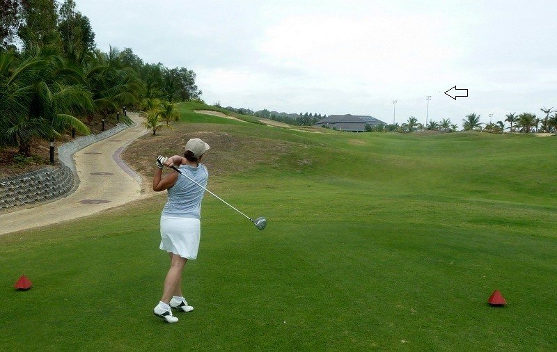 Woman Teeing Off