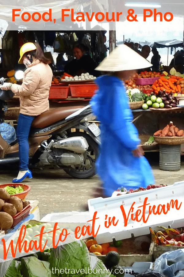 Man in Vietnamese hat walking through food market