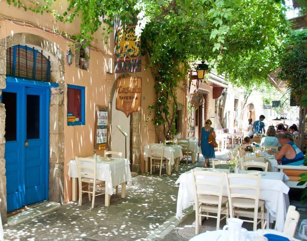 The Old Town Rethymno tables and chairs in a shady alleyway