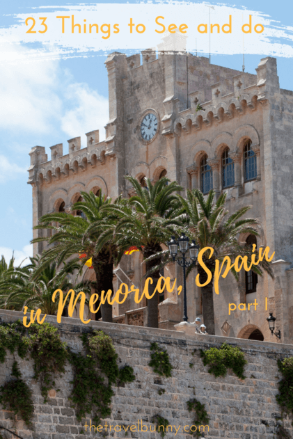 Town Hall with clock  and palm trees in Mahon Menorca