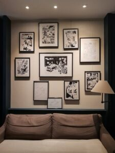picture wall with framed cartoons