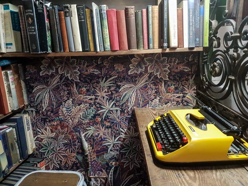 yellow typewriter and bookshelf
