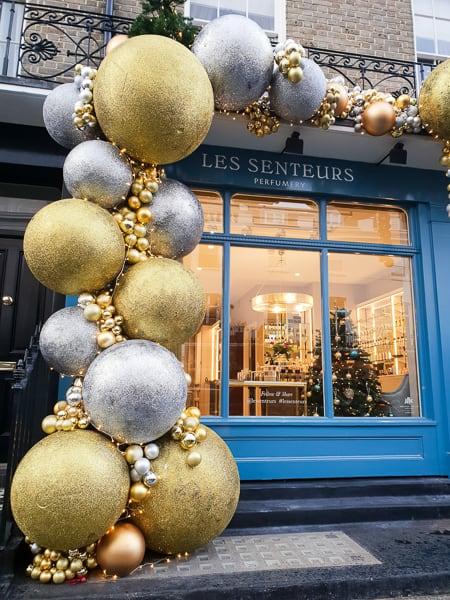 Giant Baubles on shop front London