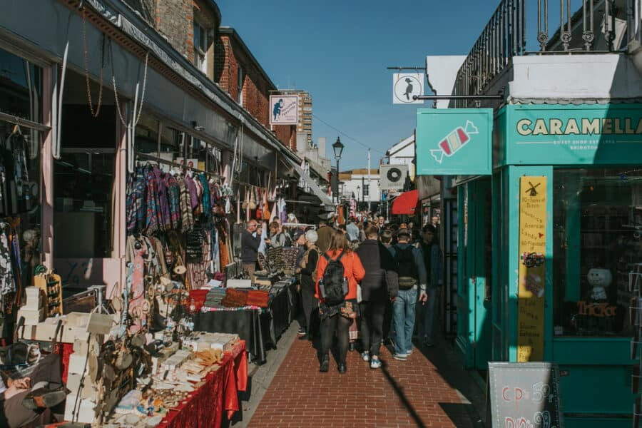 BRIGHTON, ENGLAND People walking around Brighton North Laine with shops and restaurants.