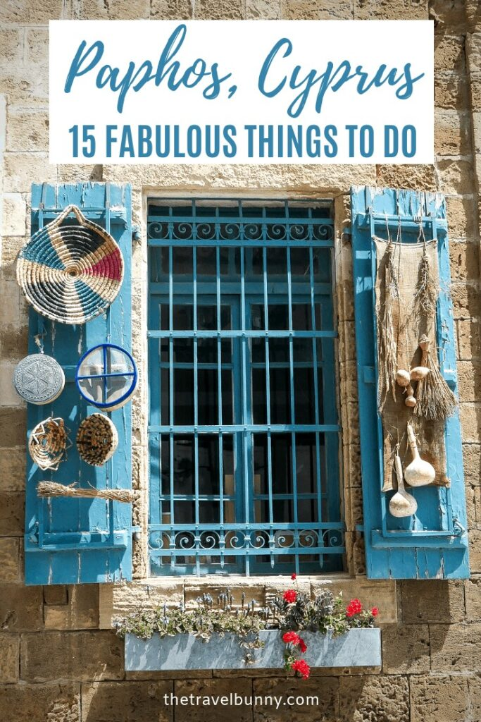 Blue shutters with handicrafts hanging from them