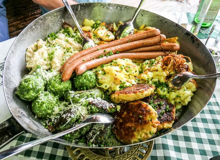 Austrian dumplings and sausages in frying pan