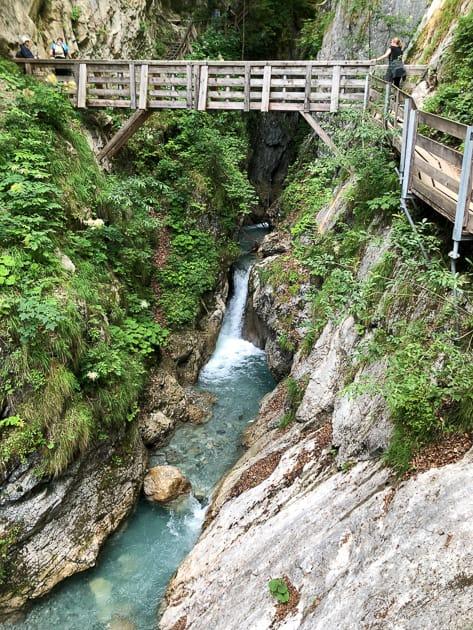 Wooden bridge over stream in gorge