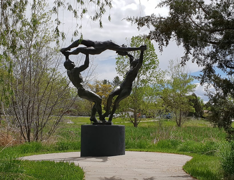 Sculpture man and two women