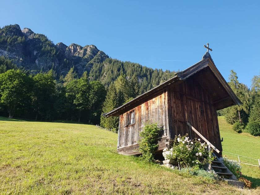 Tiny wooden chapel on Austrian hillside