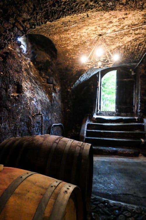Wine cellar with barrels and open door
