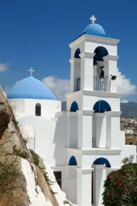 Blue domed church and white tower in Ios