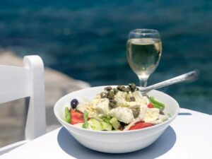 Greek saland and glass of wine