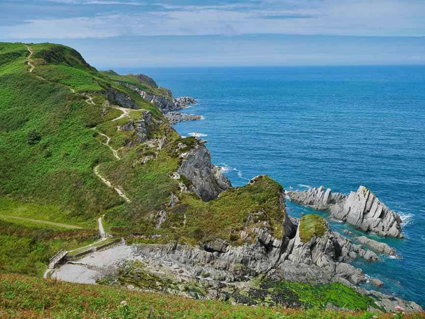 North Devon coast near Lee Bay grass topped cliffs and blue seas