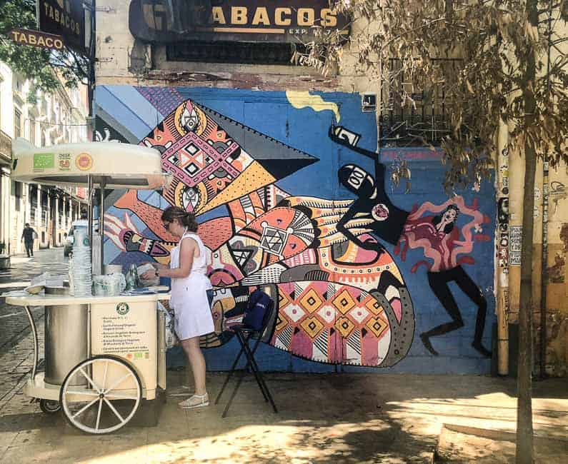 Horchata stall in Valencia next to a graffiti wall