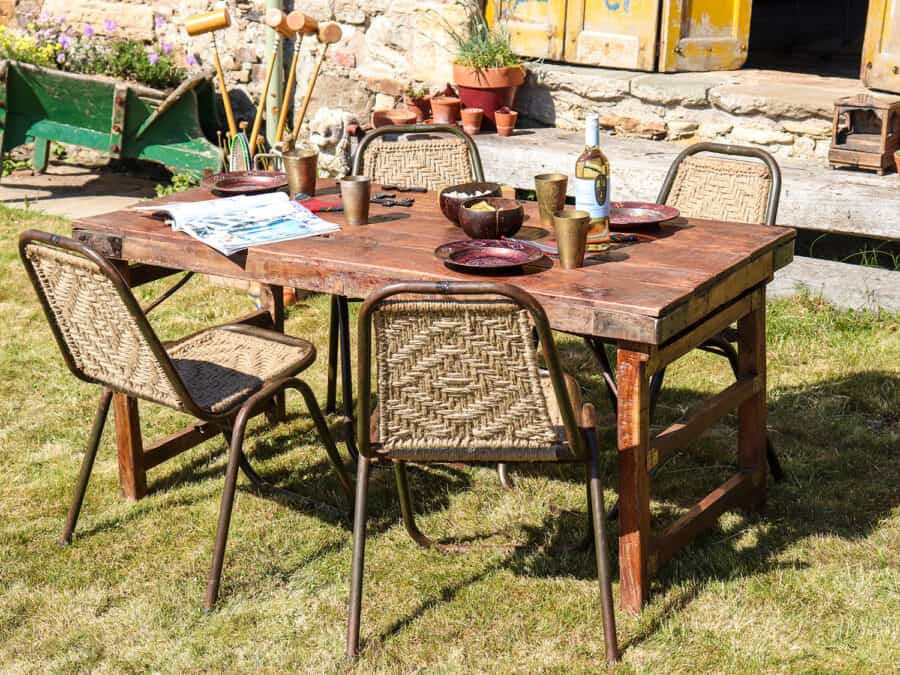 Recycled Furniture - wooden table and woven chairs in a garden setting