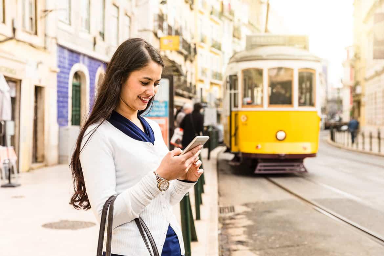 Data roaming in Europe - woman on mobile in Lisbon
